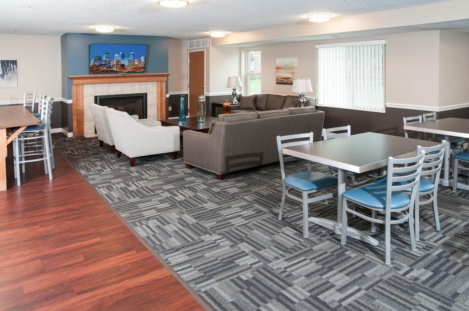 Compass Pointe Apartments Community Space with Large Couches and Kitchen Tables
