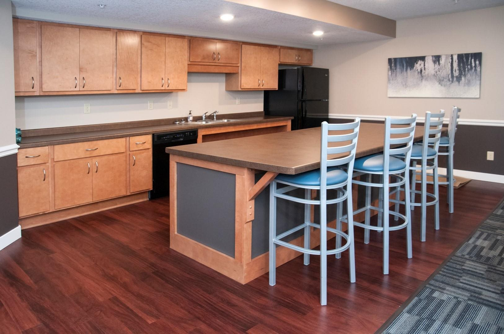 Kitchen in Community Room at Compass Pointe with Full Appliances and Bar with High Top Seating