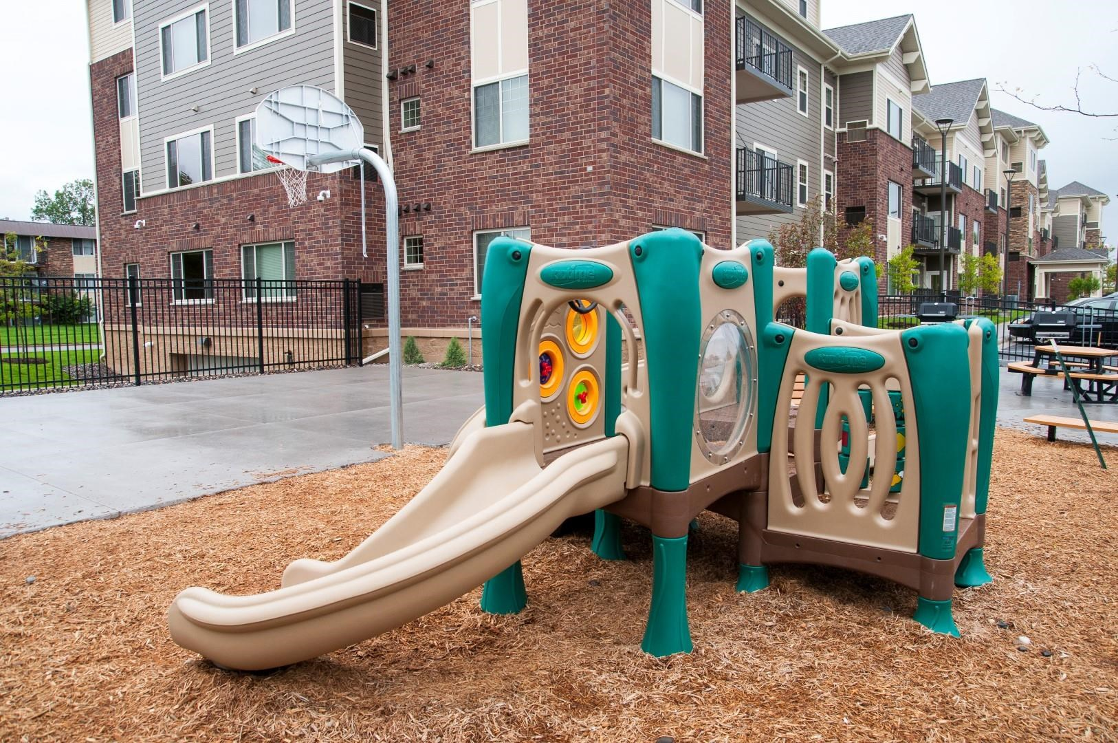 Outdoor Playground in Courtyard of New Hope Apartment