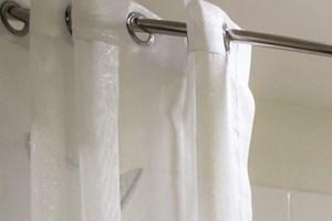 Roman Soaking Tubs | One11 Apartments
