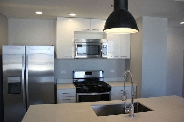 kitchen with stainless steel appliances and pendant lighting