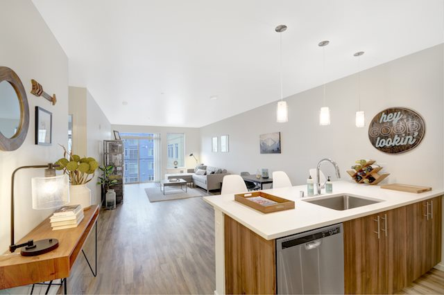 Spacious Living Room and Dining Area  at The Whittaker, Washington 98116