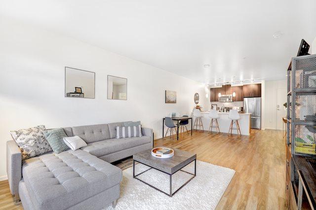living room with hardwood flooring  at The Whittaker, Washington 98116