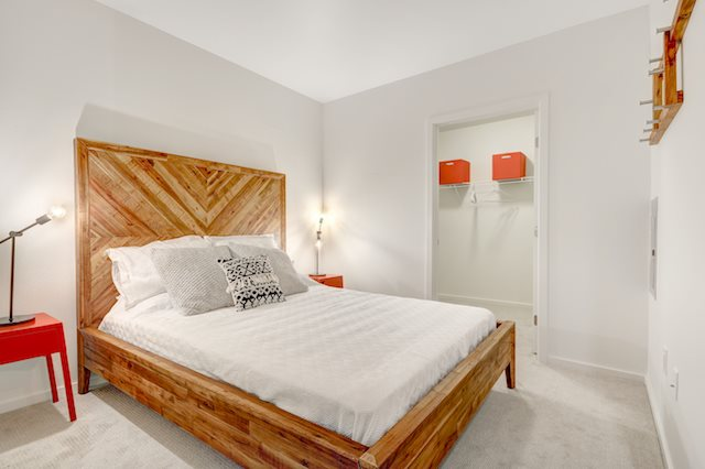Spacious soft carpeted bedrooms with walk-in closets. at The Whittaker, 98116