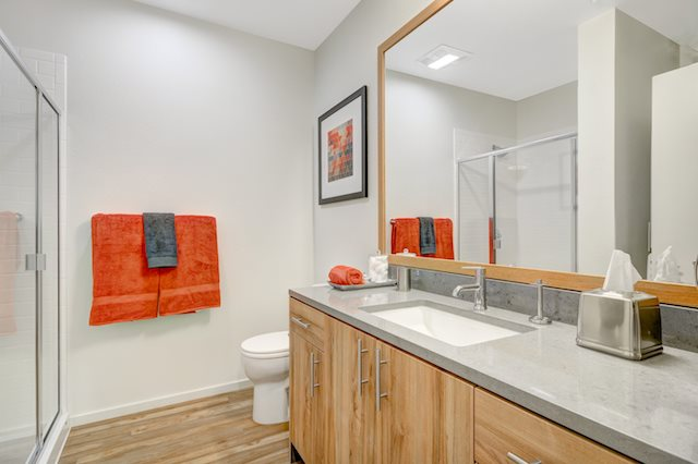 Bright bathrooms with vanity storage.