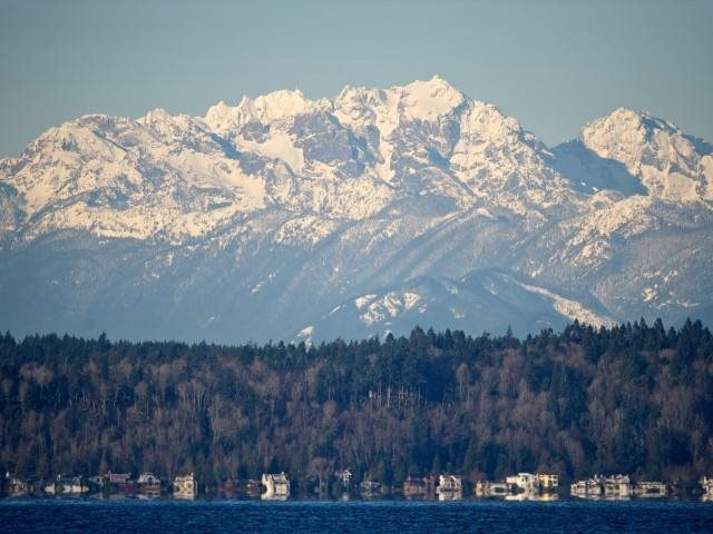The Olympic mountains provide a close getaway destination near by The Whittaker, Seattle,