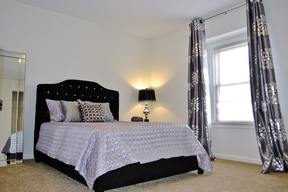 Bedroom with natural light at 300 at the Circle Apartments in Lexington, KY