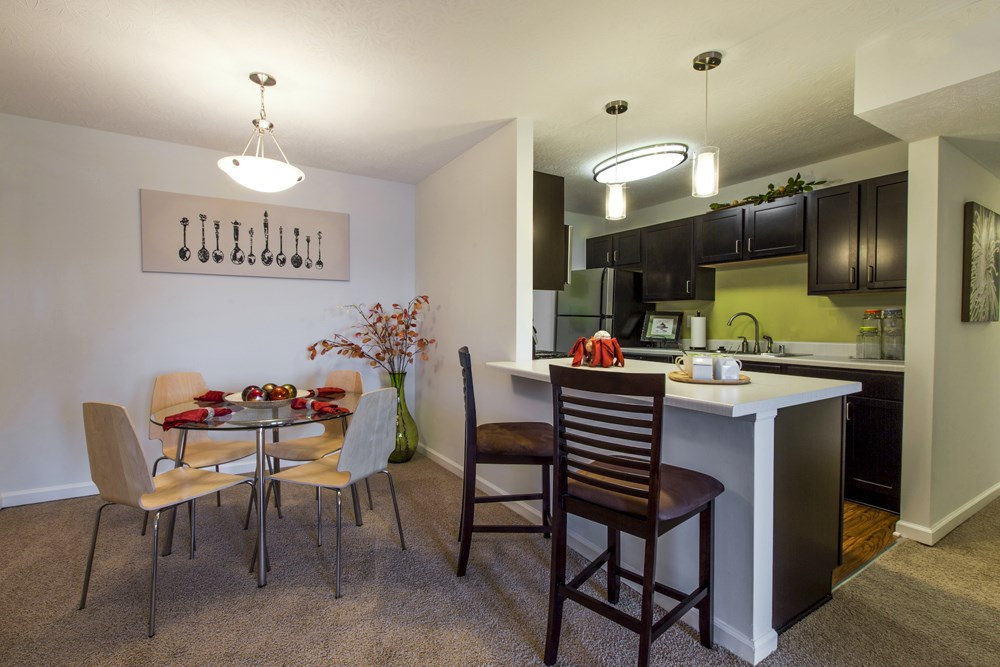 Kitchen and dining room at 300 at the Circle Apartments in Lexington, KY