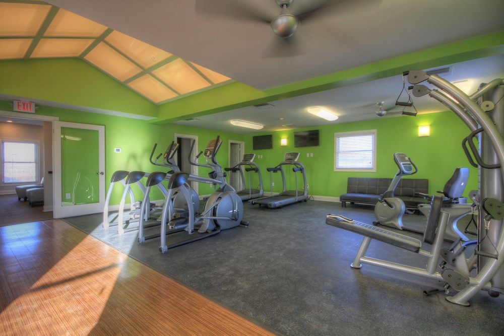 Fitness center with yoga studio at 300 at the Circle Apartments in Lexington, KY