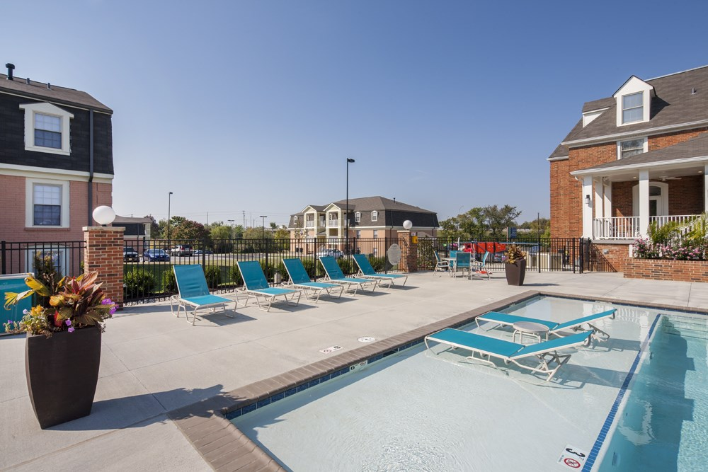 Lounge chairs by the pool at 300 at the Circle Apartments in Lexington, KY