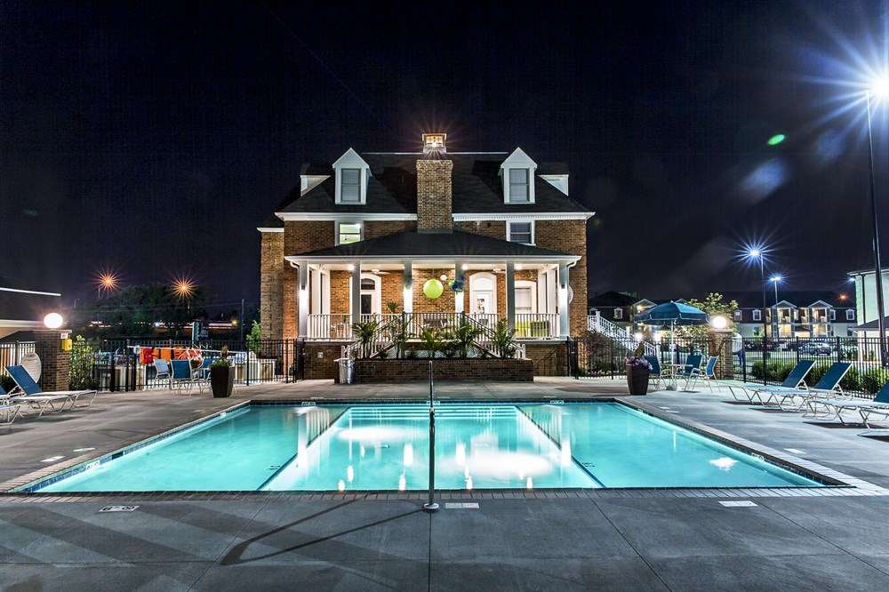 Night photo of lighted pool at 300 at the Circle Apartments in Lexington