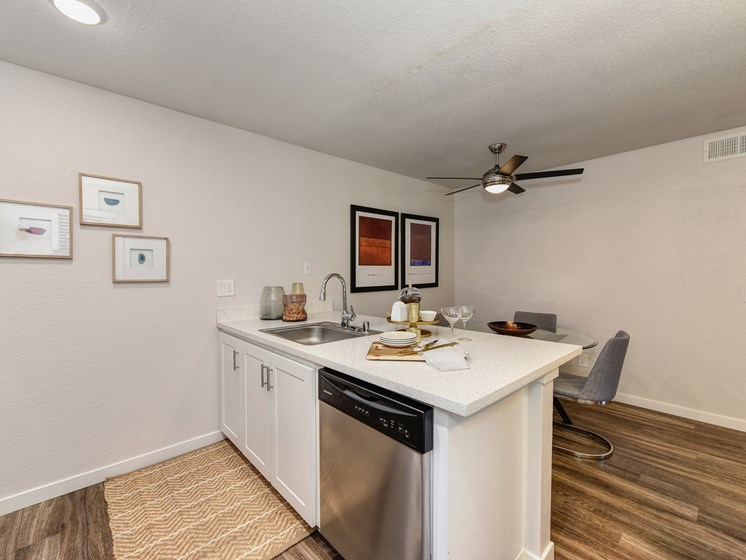 Luxury Apartment Community Kitchen with Dishwasher and View of Dining Area