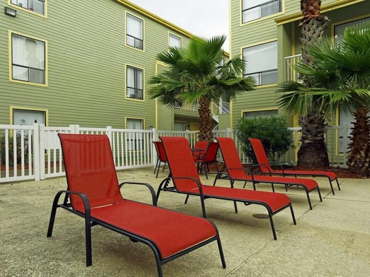 Red Relaxing chairs at Carelton Courtyard, Galveston, TX, 77550
