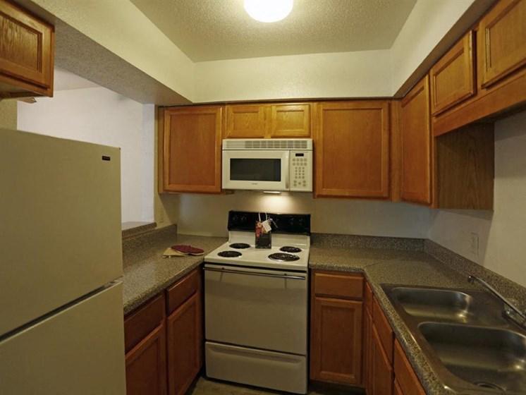 Modern Kitchen With Custom Cabinet at Carelton Courtyard, Galveston, Texas