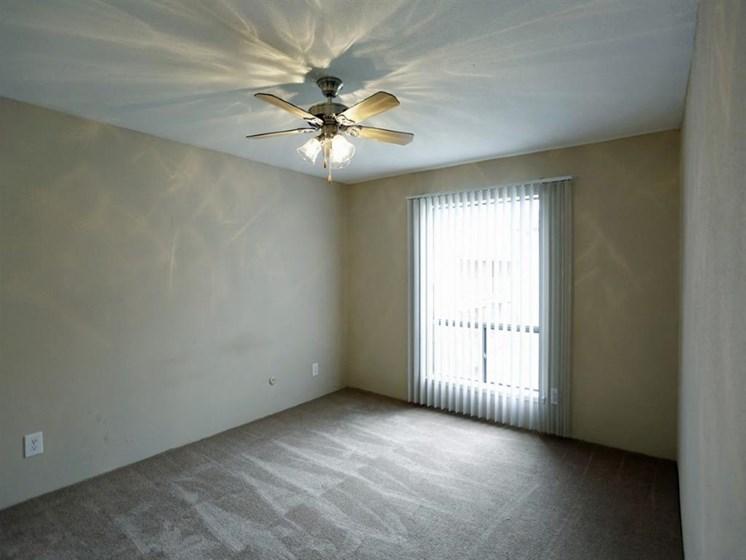 Glass Door,Ceiling Fan In Living Room at Carelton Courtyard, Galveston, TX
