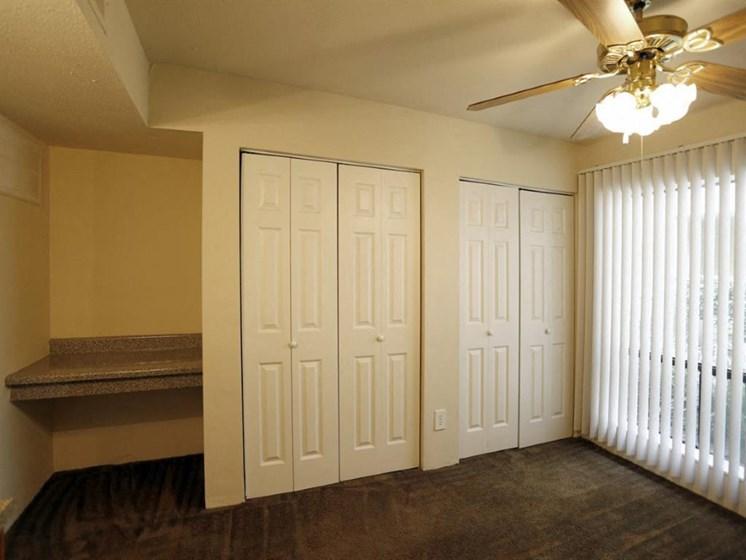 Walk-In Closet And Living Room  at Carelton Courtyard, Galveston, Texas