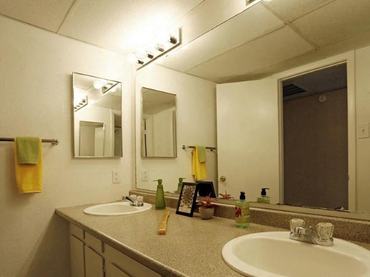 Bathroom with vanity sink, Mirror at Carelton Courtyard, Texas