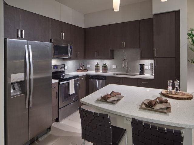 Our luxury kitchens feature stainless steel appliances and quartz counter tops at at Windsor at Doral, Miami,FL 33178