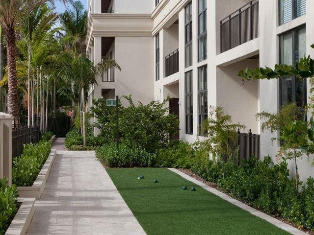 Challenge someone to a game of Bocce ball.