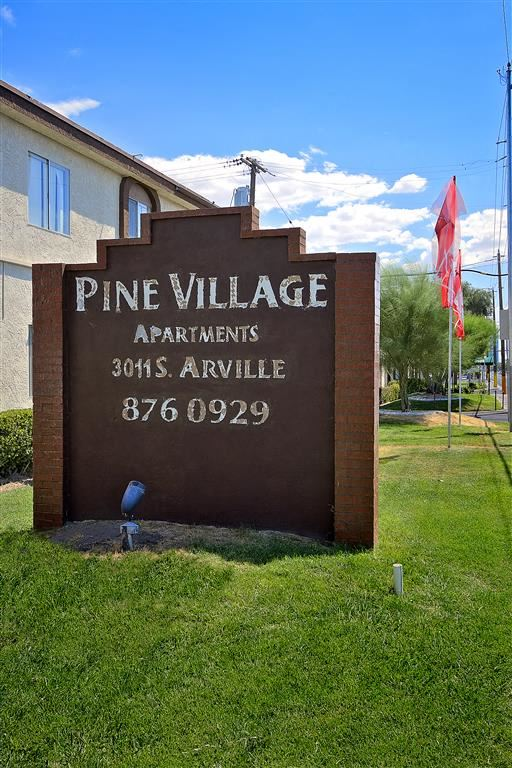 pine village apartments sign