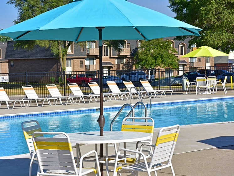 Poolside Seating with Umbrella at Windsor Place, Davison, MI, 48423