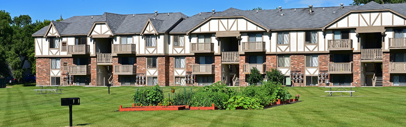 Lush Landscaping And Park-Like Setting at Huntington Place Apartments, Essexville, 48732