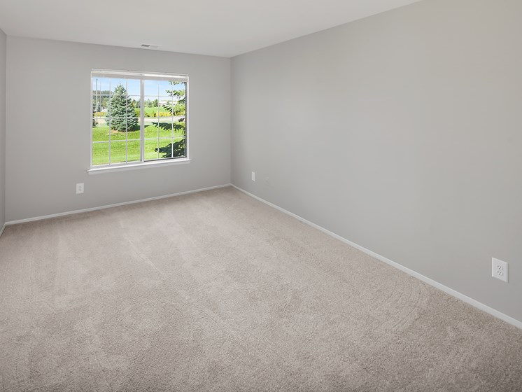 Bedroom with Natural Light at The Heights Apartments in Madison Heights, MI