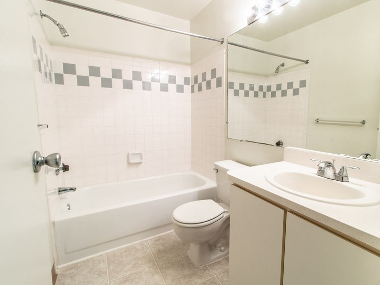 Tiled Bathroom at The Heights Apartments in Madison Heights, MI