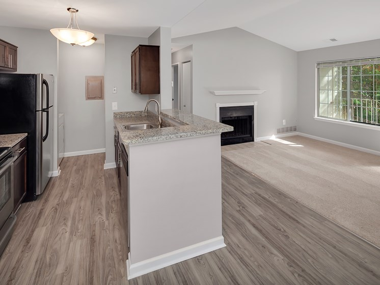 Kitchen and Fireplace at The Heights Apartments in Madison Heights, MI