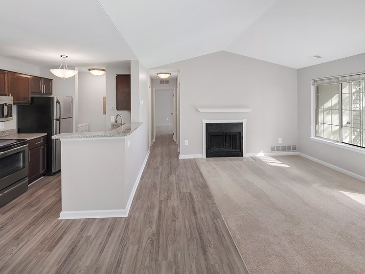 Open Living Room with Fireplace at The Heights Apartments in Madison Heights, MI