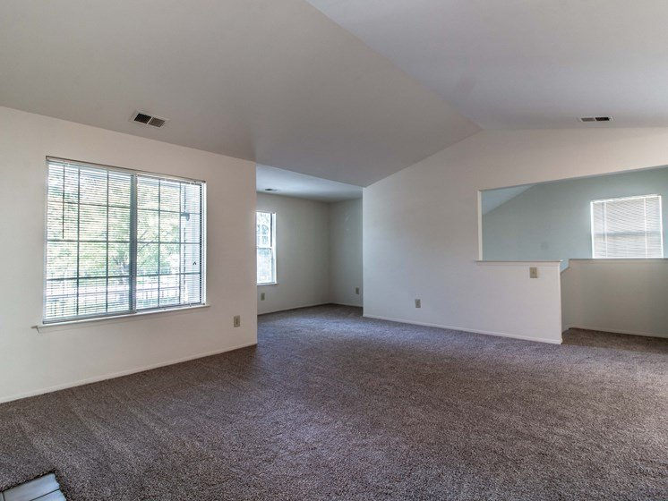 Living Room with Natural Light at The Heights Apartments in Madison Heights, MI