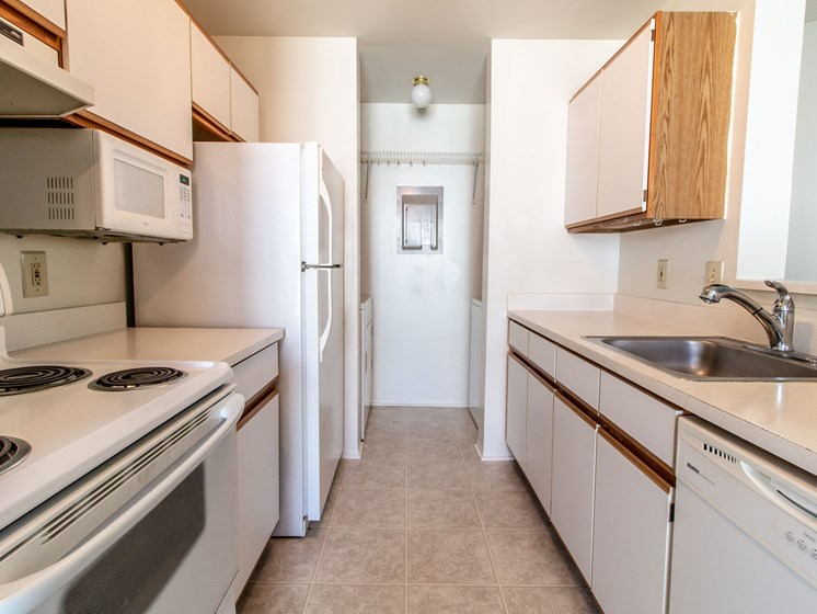 Ample Cabinetry and Counter-top Space at The Heights Apartments in Madison Heights, MI