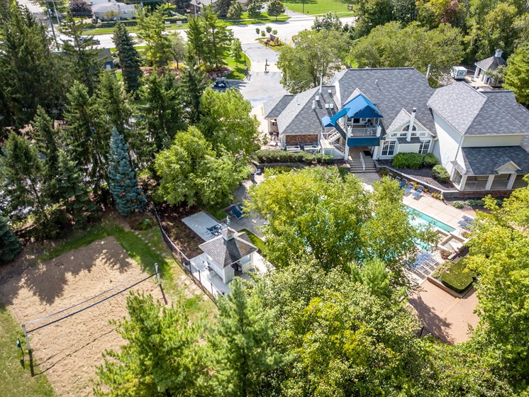 Clubhouse, Pool, and Volleyball Court at The Heights Apartments in Madison Heights, MI