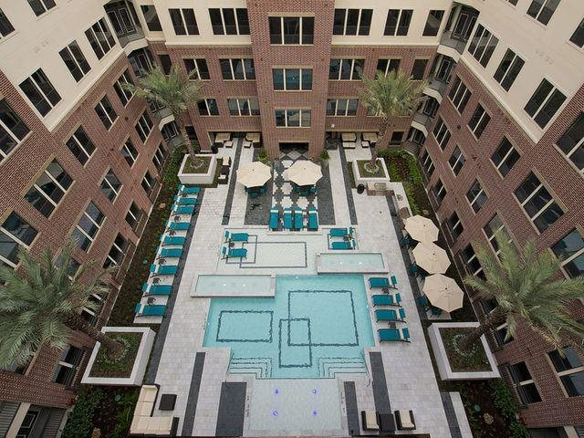 Poolside Sundeck and Grilling Area at Midtown Houston by Windsor, Houston, TX 77002
