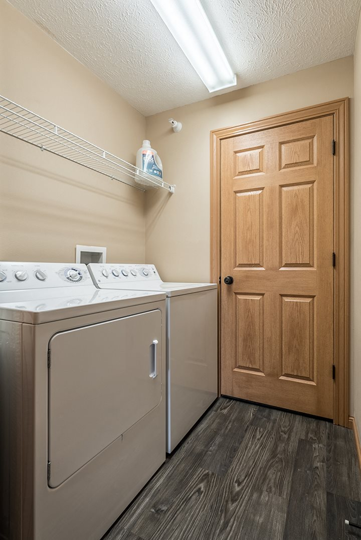 Full sized washer and dryer available in unit at Grand Legacy Apartments