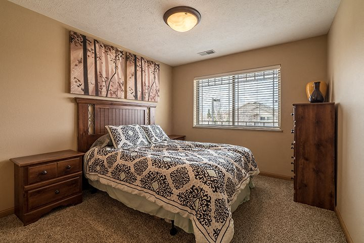 Large bedroom with lots of natural lighting at Grand Legacy Apartments