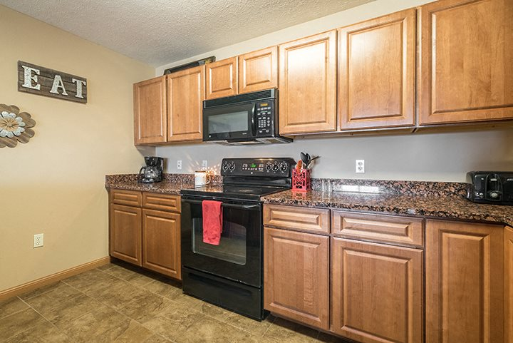 Kitchen with lots of cabinet space at Grand Legacy Apartments