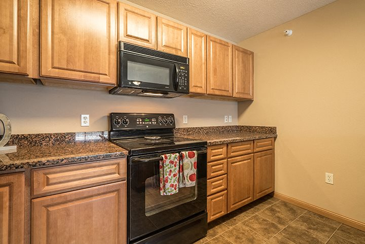 Kitchen with updated appliances at Grand Legacy Apartments