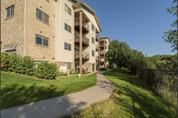 Exterior View Of Balconies Overlooking Zorinsky Lake At Grand Legacy Apartments And Townhomes In West Omaha