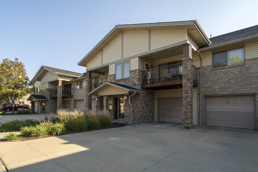 Exterior view of townhome-style apartment with attached garages at Grand Legacy apartments and townhomes in west Omaha NE 68130