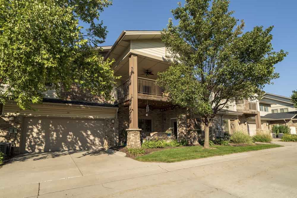 Townhome-style villas with one- and two-car attached garages  at Grand Legacy apartments and townhomes in west Omaha NE 68130