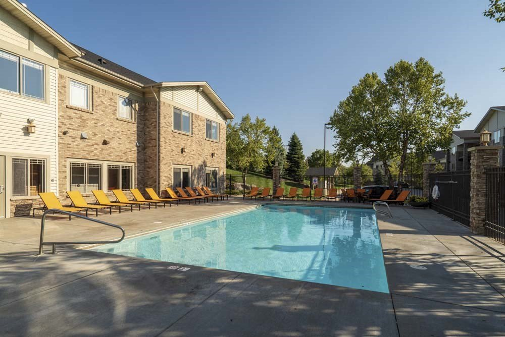 Swimming pool with seating  at Grand Legacy apartments and townhomes in west Omaha NE 68130