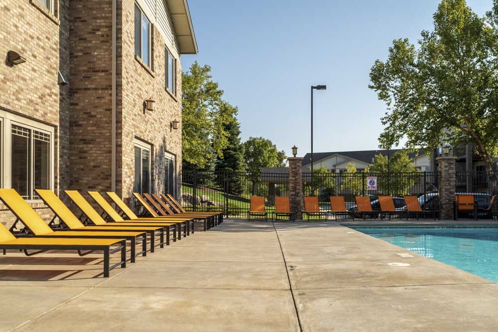 Poolside reclining lounge seats  at Grand Legacy apartments and townhomes in west Omaha NE 68130