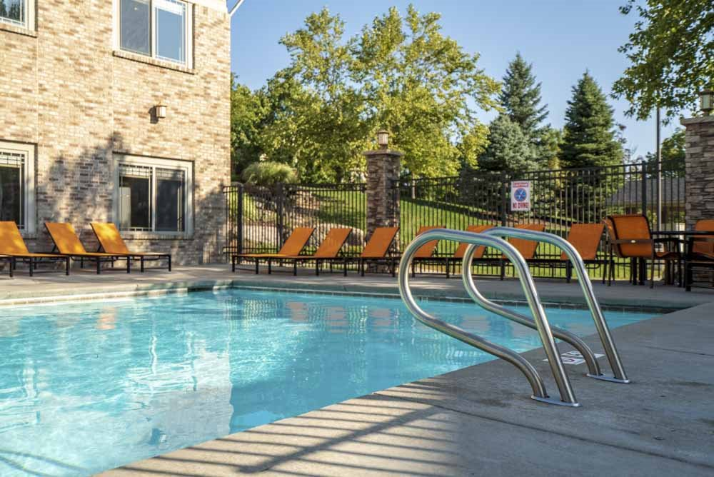 Swimming pool with poolside seating  at Grand Legacy apartments and townhomes in west Omaha NE 68130