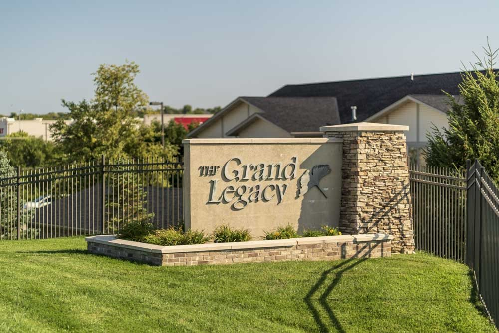 The Grand Legacy exterior sign at Grand Legacy apartments and townhomes in west Omaha NE 68130