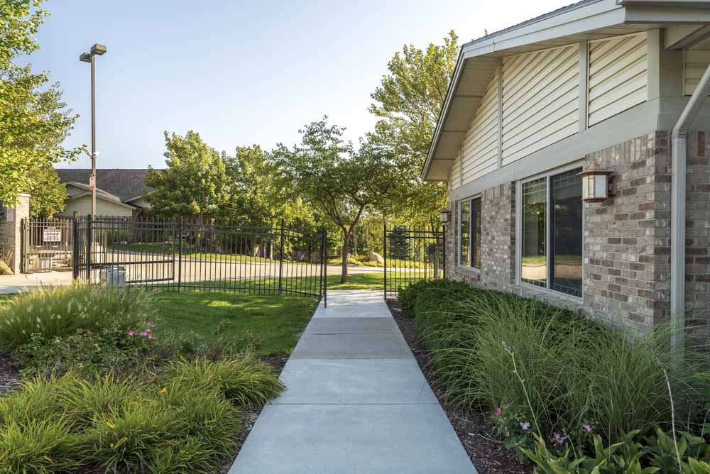 Gated entrance to Grand Legacy apartments and townhomes in west Omaha NE 68130