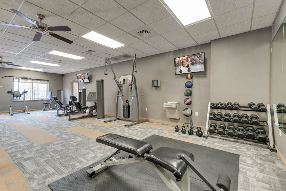 24-hour fitness center with free weights, TV and weightlifting machines  at Grand Legacy apartments and townhomes in west Omaha NE 68130