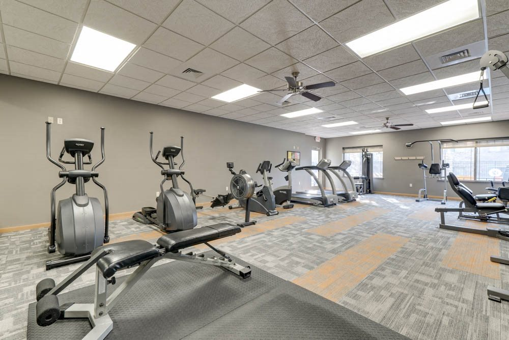 24-hour fitness center with cardio and weightlifting equipment