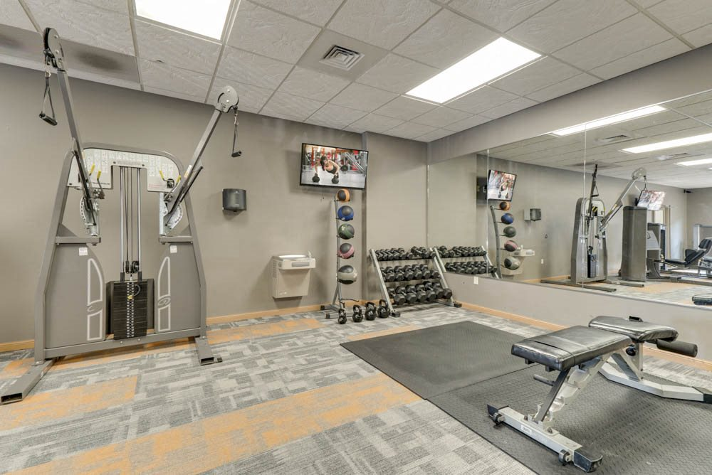 Fitness center with free weights and weightlifting equipment  at Grand Legacy apartments and townhomes in west Omaha NE 68130