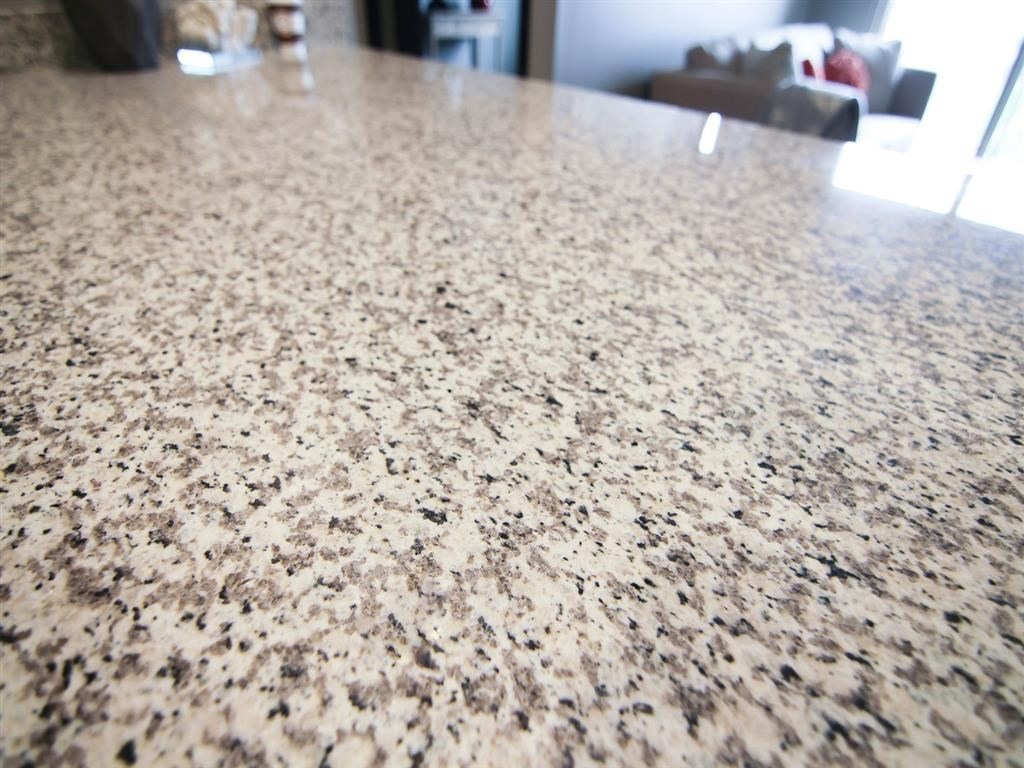 Light granite countertops at The Flats at 84 apartments in Lincoln NE